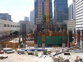 Crane footing, concrete core and construction equipment in August 2006.