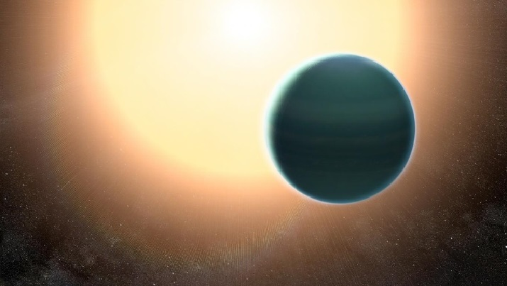 "An unexpectedly primitive atmosphere surrounds the ""distant Netpune"" planet HAT-P-26b. Image credit: NASA/GSFC"