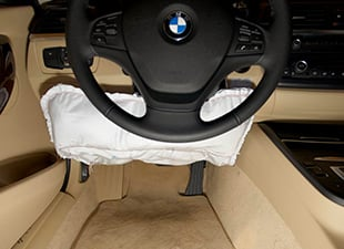 Knee airbag installed in a BMW. Credit: IIHS.
