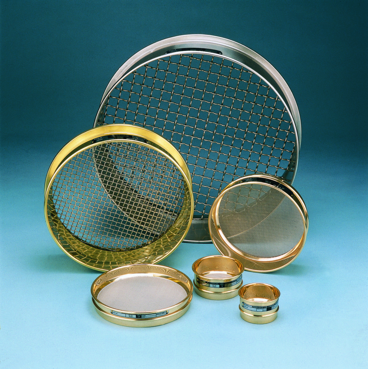 Figure 2 – Abrasive grit size is derived from ANSI and FEPA measurement systems based on ASTM E-11 standard compliant mesh test sieves. (Source: CSC Scientific Company)
