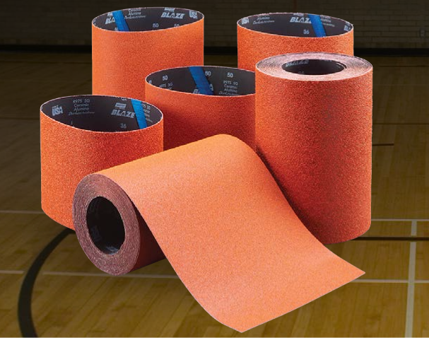 Figure 6  – Norton Blaze® floor sanding covers (belts or sleeves and rolls) leverage proprietary seeded gel abrasives to provide unrivaled performance in floor finishing in educational auditoriums, sport facilities and commercial buildings. (Source: Norton Abrasives)