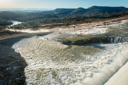 Water flowed over an auxiliary spillway after Lake Oroville water levels exceeded 901 feet elevation above sea level.
