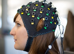NIRS/EEG brain computer interface system applied to a model. Credit: Wyss Center for Bio and Neuroengineering