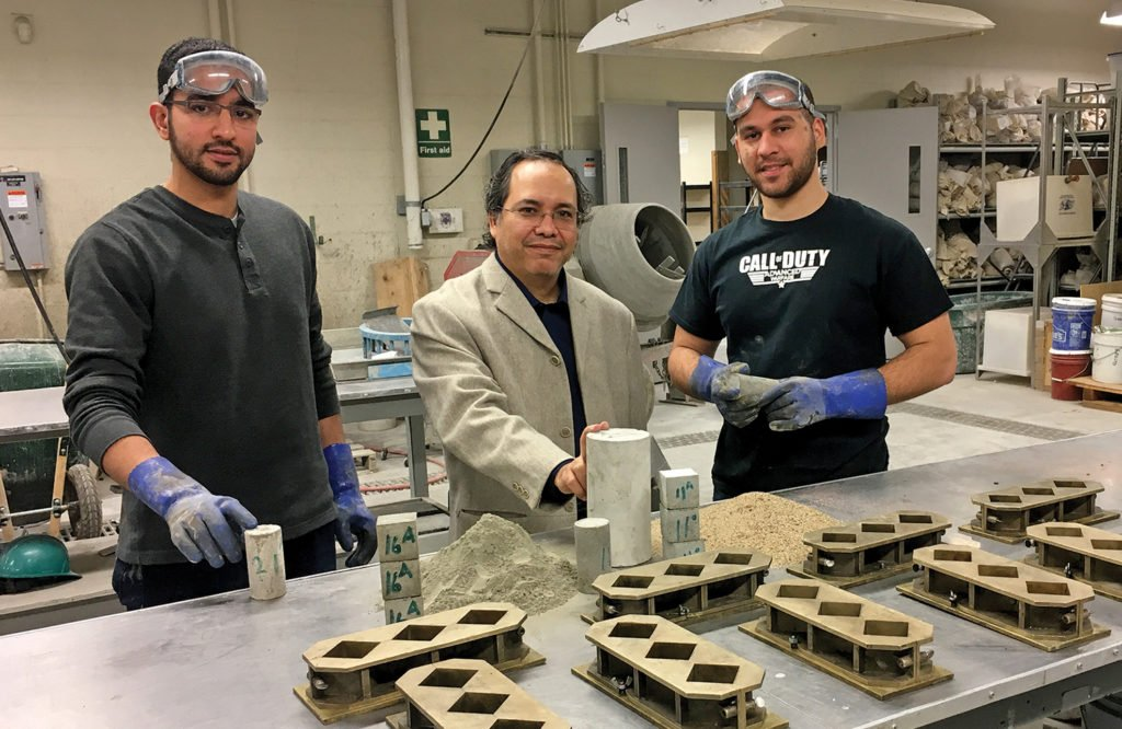 Missouri S&T professor Mohamed ElGawady, center, and S&T students are studying making concrete with fly ash instead of Portland cement. Source: Joann Stiritz/Missouri S&T