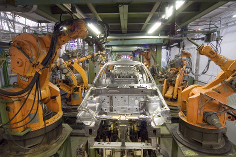 Figure 2: Industrial robots on the assembly line in a car manufacturing plant. Source: Mixabest / CC BY-SA 3.0