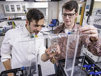 University of Colorado Boulder graduate students examine a soft robotic material. Source: University of Colorado Boulder