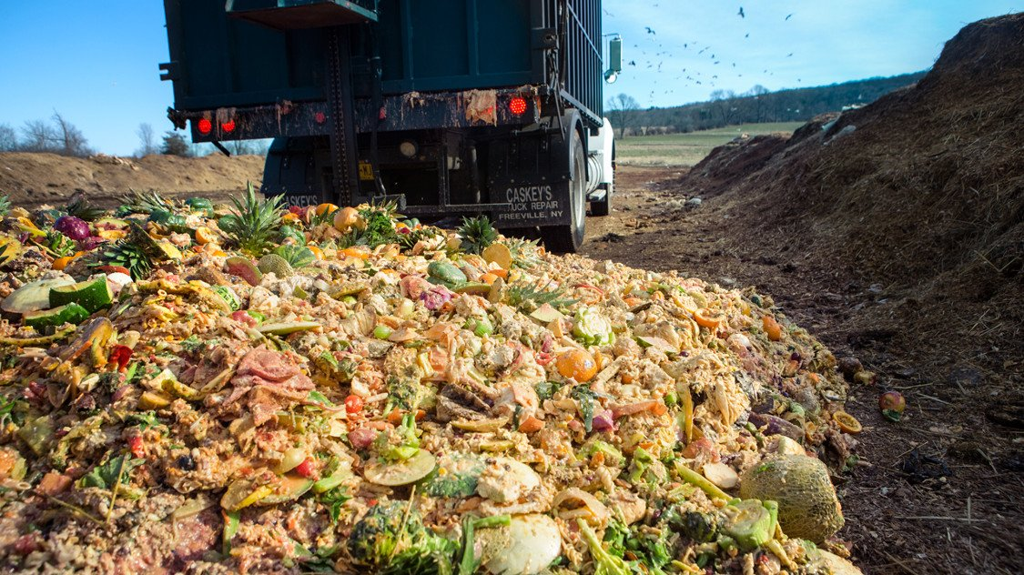 A truck dumps Cornell dining hall food waste at the university's composting facility in March 2017. (Source: Robert Barker/University Photography)