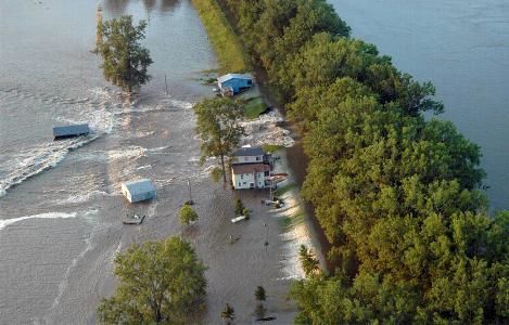 The Iowa River floods the town of Oakville, Iowa, following a levee breach in June 2008.