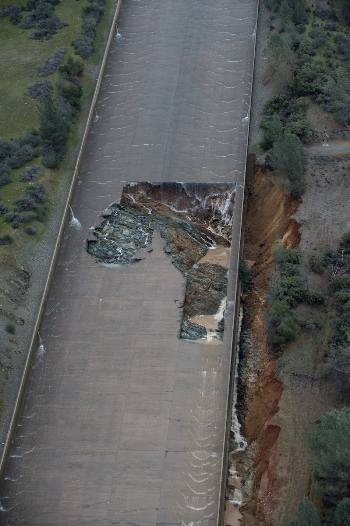 Photo from February shows spillway crater and nearby erosion.