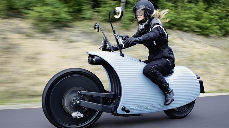Why is electric motorcycle development behind EVs?