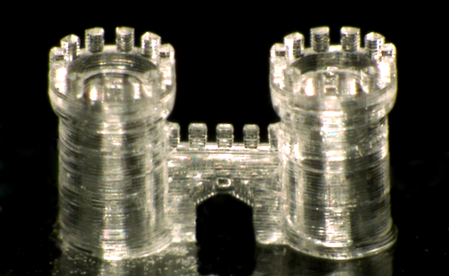 A three-dimensional structure of a castle gate printed in fused silica glass. Image credit: NeptunLab/KIT