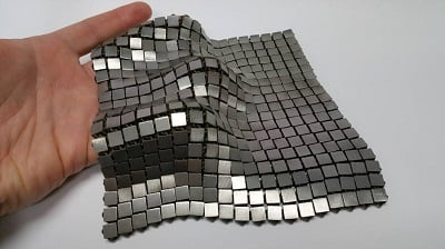"This metallic ""space fabric"" was created using 3-D-printed techniques that add different functionality to each side of the material. Image credit: NASA/JPL-Caltech"