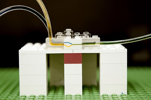 A researcher builds a microfluidic system using Legos. Source: MIT