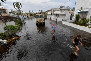 Officials inspect flooding damage in the days after Hurricane Maria struck Puerto Rico. Credit: NYPA