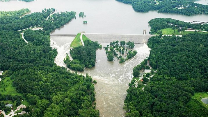 The Coralville Dam overflowing its spillway during the Iowa Flood of 2008, which cost $10 billion in damages. Image credit: U.S. Army Corps of Engineers.
