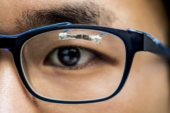 University of Washington researcher demonstrates how wearable sensors can track eye movement. Source: Dennis R. Wise/University of Washington
