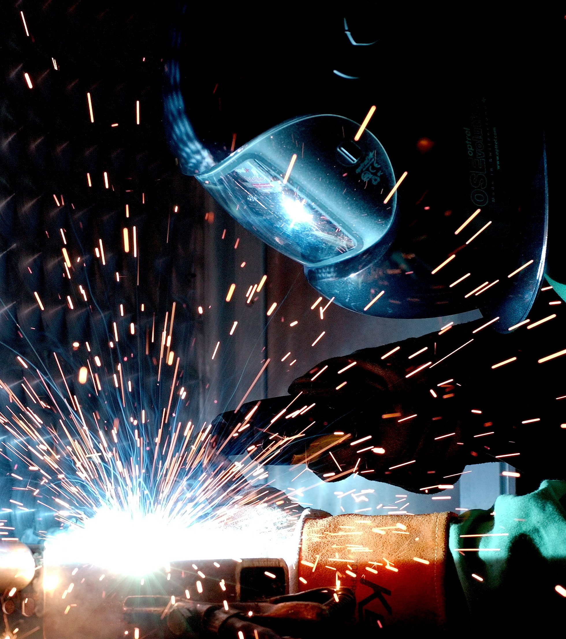 Humans are less efficient welders than robots because they cannot operate all day, every day.